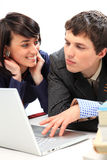 Couple looking at laptop. Royalty Free Stock Photos