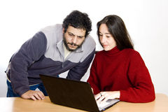 Couple looking at laptop Stock Images
