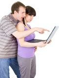 Couple looking at laptop Royalty Free Stock Images