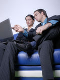 Couple looking at laptop Royalty Free Stock Photography