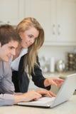 Couple looking at laptop Stock Photos