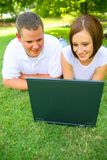 Couple Looking At Laptop With Smile Royalty Free Stock Images