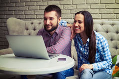 Couple looking at laptop Stock Photos