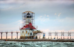 Couple looking at the Lighthouse restoration royalty free stock image