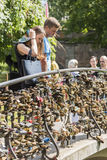 Couple looking at love locks Riga Stock Photos