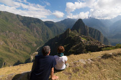 Couple looking at Machu Picchu, Peru, from above Stock Images