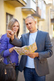 Couple looking at the map in city Stock Photography