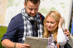 Couple looking at map on city break Royalty Free Stock Photography