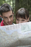 Couple Looking At Map Royalty Free Stock Photos