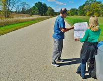A couple looking at a map. A couple looking at a map for directions on a country road Royalty Free Stock Photo