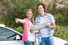 Couple looking at the map Stock Photos
