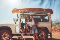 Couple looking at the map in their car Stock Image