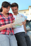 Couple looking at a map Royalty Free Stock Photo