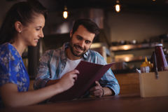 Couple looking at menu. In bar Royalty Free Stock Photo