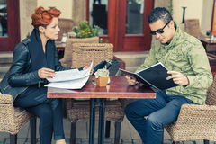 Couple looking at the menu Royalty Free Stock Photos