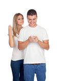 Couple looking the mobile Stock Photos