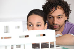 Couple looking at model housing Stock Images