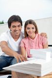 Couple Looking At Model Structure Royalty Free Stock Photo