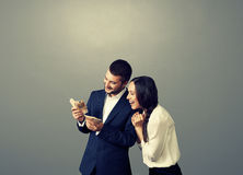 Couple looking at money over dark Royalty Free Stock Photography