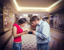 Couple looking for money Royalty Free Stock Photo