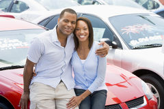 Couple looking at new cars. On lot Royalty Free Stock Image