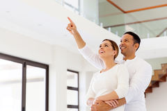 Couple looking new house. Lovely couple looking at their new house Stock Photos