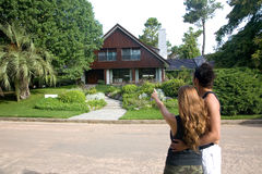 Couple looking for a new house. Young couple looking for a new house royalty free stock photo