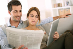 Couple looking at news from home Royalty Free Stock Images