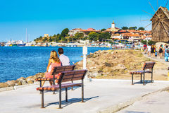 Couple looking at old town of Nesebar in Bulgaria by the Black sea Stock Photos