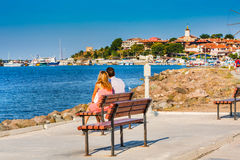 Couple looking at old town of Nesebar in Bulgaria by the Black sea Royalty Free Stock Image