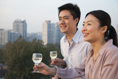 Couple Looking Out Over Cityscape Stock Image
