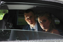 Couple looking out window car, while the rear seat Stock Photography