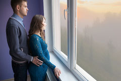 The couple is looking out the window Stock Photography