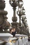 Couple Looking Over Bridge Through Streetlights Stock Photos