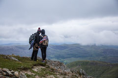 Couple looking over the horizon. In Snowdonia Royalty Free Stock Photos