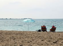Couple looking over Lake Huron at Chantry Island stock photography