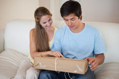 Couple looking at a package Stock Photography
