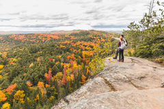 Couple looking at panorama from the top of the rocks Royalty Free Stock Image