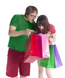 Couple Looking Into Paper Bag in Amaze Expression Stock Photo