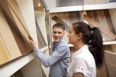 Couple looking at parquet board for home flooring in store Stock Photo