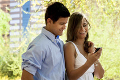 Couple looking at a phone Stock Images