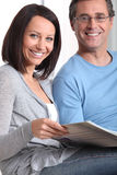 Couple looking at photo album Royalty Free Stock Photography