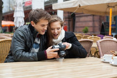 Couple Looking Photographs On Digital Camera Royalty Free Stock Photo