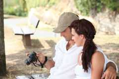 Couple looking at photos Stock Images