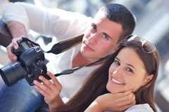 Couple looking photos on camera Royalty Free Stock Photography