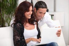 Couple looking at photos Royalty Free Stock Photos