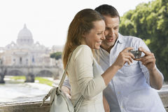 Couple Looking At Pictures On Digital Camera Stock Images