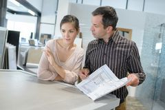 Couple looking for plans new house Royalty Free Stock Photography