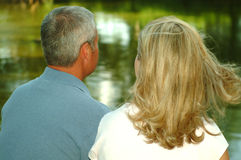 Couple Looking at Pond. Married couple looking out over the pond at the park Stock Photos