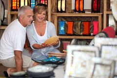 Couple looking pottery on holiday Stock Images